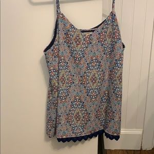 Cute patterned tank top only worn a few times :)